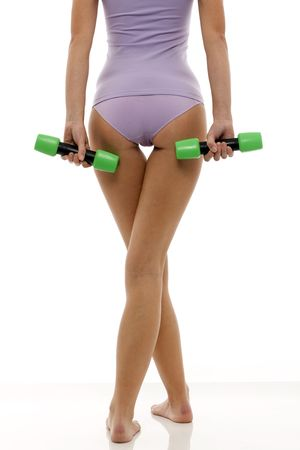 sportruházat: legs of a young caucasian woman in lingerie back with dumbbells in hand