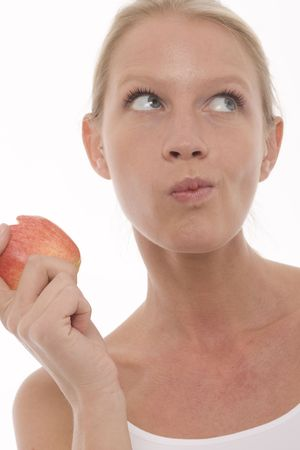 young beautyful caucasian woman eating and holding apple in the hand photo