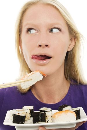portrait of a young caucasian woman eating sushi photo