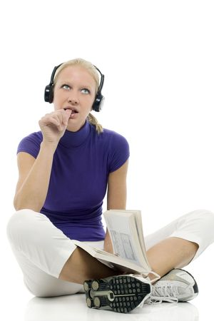 portrait of a young caucasian woman with casual clothing with book and headphones photo
