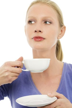 portrait of a young caucasian woman drinking a cup of tea photo