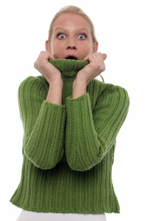 turtleneck: portrait of a scared young caucasian woman with green turtleneck Stock Photo
