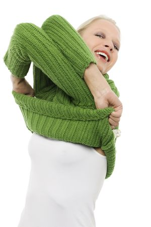stripping: portrait of a young caucasian woman with green turtleneck undressing