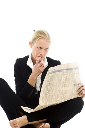 portrait of a young caucasian woman wearing a black jacket sitting down and reading a newspaper looking for work Stock Photo - 6826315