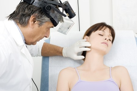 man doctor visit a young caucasian woman