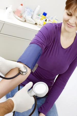 sitted: doctor measuring blood pressure