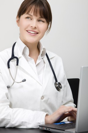 portrait of a young caucasian woman doctor with laptop Stock Photo - 7031103