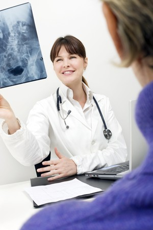 patient and female doctor examining an X-ray Stock Photo - 7608676