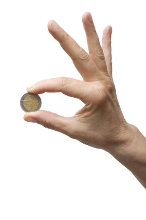 one item: one hand holding a coin