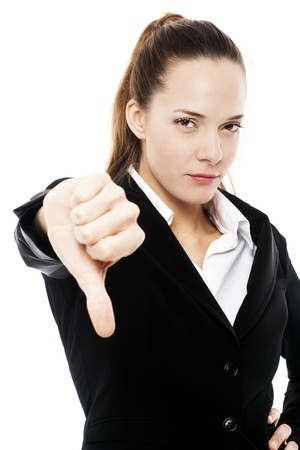 severe businesswoman with thumb down on white background studio Stock Photo - 7645235