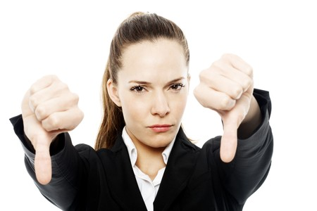 THUMBS DOWN: severe businesswoman with thumb down on white background studio