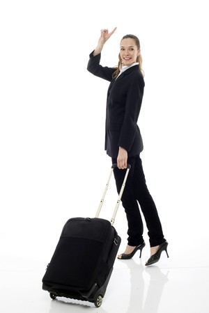 Young businesswoman with trolley on white background studio photo
