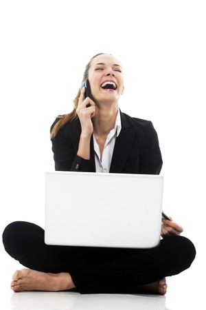 young businesswoman with laptop on the floor on white background studio photo