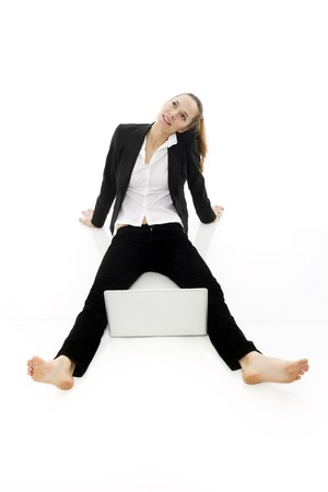 young businesswoman with laptop on the floor on white background studio Stock Photo - 7644886