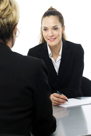 two women during a business meeting on white background studio photo