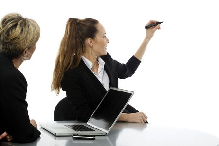 two women during a business meeting with laptop on white background studio photo