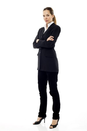 angry women: Young businesswoman standing with arms crossed on white background studio