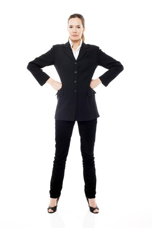 arms akimbo: Young businesswoman standing with arms akimbo on white background studio