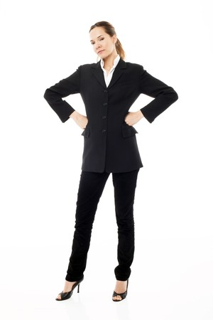 Young businesswoman standing with arms akimbo on white background studio photo