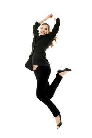 woman arms up: Young businesswoman jumping on white background studio