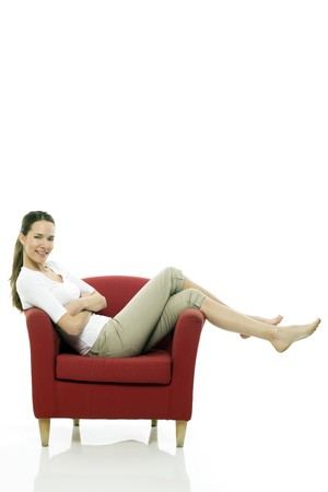 only one woman: Young woman sitting on a chair on white background studio