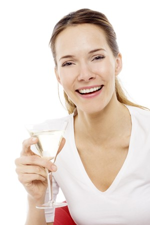 Young woman drinking a cocktail on white background studio photo