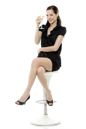 sat: elegant young woman drinking a cocktail on white background studio