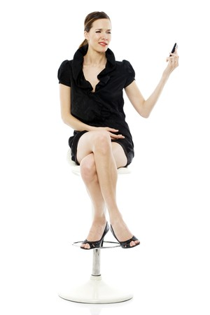 smart woman sitting on a stool holding a cellphone on white background photo