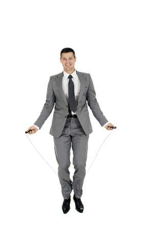 businessman jumping rope photo