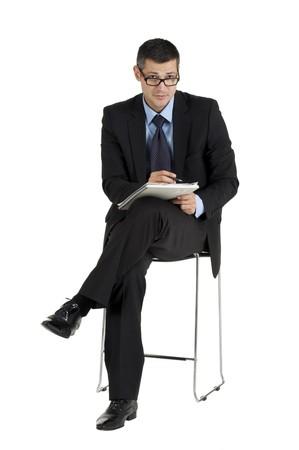 sitting businessman with eyeglasses writing photo