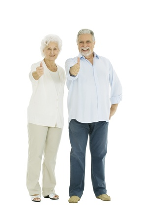 happy elderly couple with a thumbs-up photo