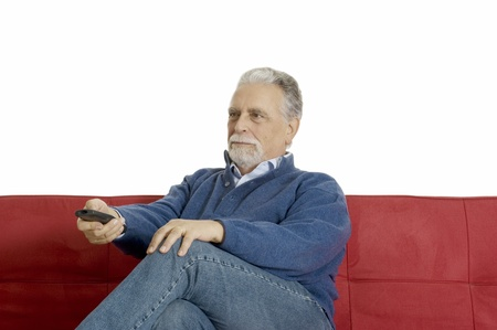 seriousness: old man on the sofa with television remote control