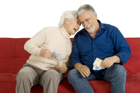 elderly couple on the couch with money in hand photo
