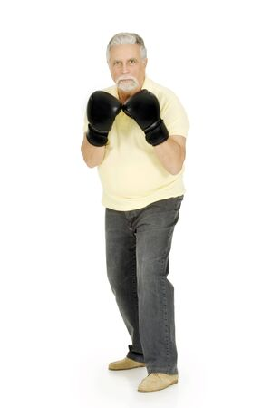 elderly man with boxing gloves photo
