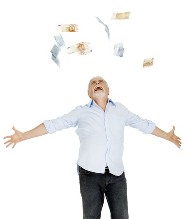 calculating: old man throws money in the air Stock Photo