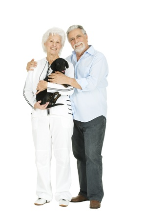 elderly couple with a dachshund photo