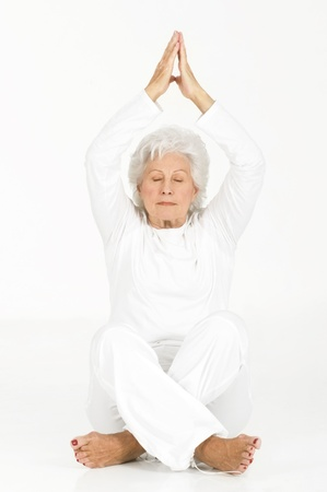 senior yoga: elderly woman practicing yoga