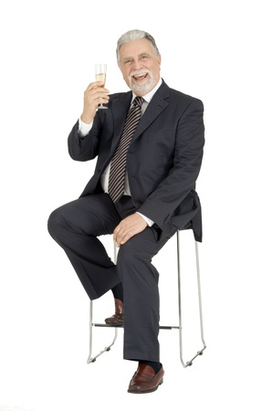 toasting: old man with glass of champagne