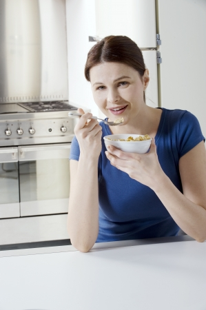 woman eating cereal with milk Stock Photo - 8542224
