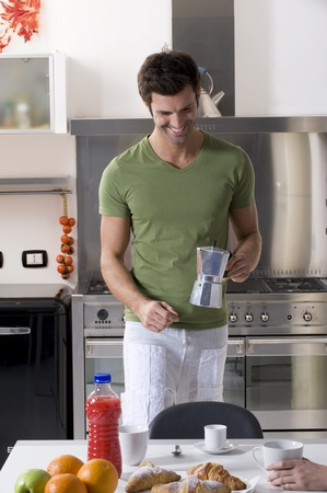 man in the kitchen preparing breakfast Stock Photo - 8542226
