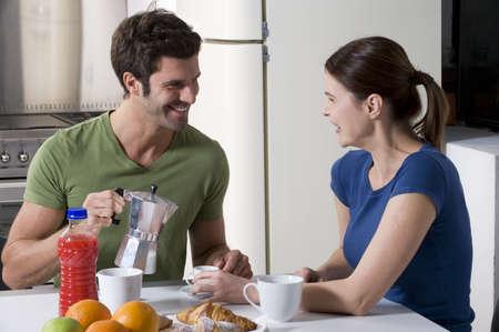couple having breakfast in the kitchen Stock Photo - 8549880