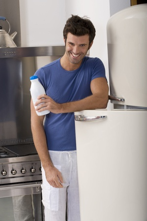 man in the kitchen with a bottle of milk Stock Photo - 8549940