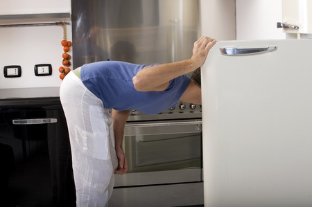 man opening the refrigerator photo