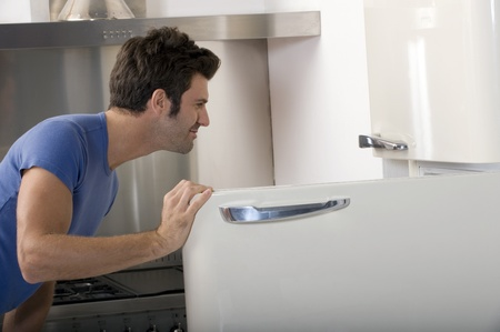 man opening the refrigerator Stock Photo