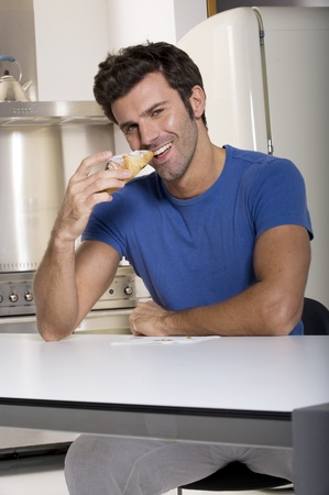 man eating a croissants Stock Photo - 8550089