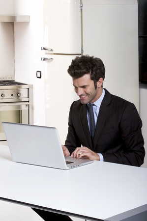 man in the kitchen with laptop Stock Photo - 8549655