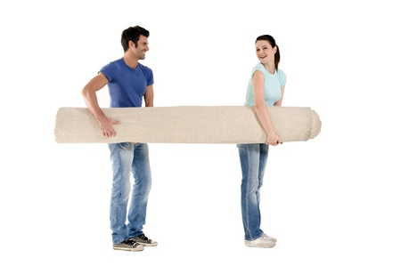 couple carrying a carpet Stock Photo
