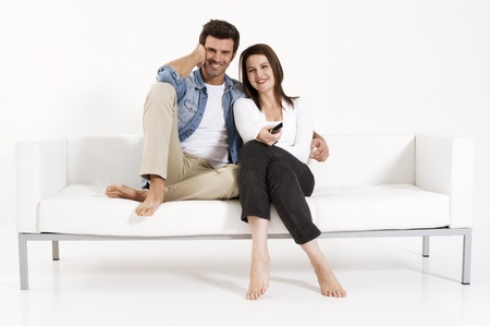 Couple on the couch watching TV photo