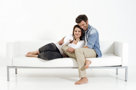 Couple on the couch watching TV Stock Photo