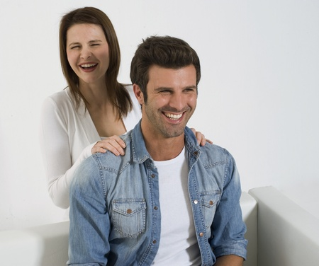 woman massaging the shoulders of man photo